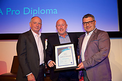 NEWPORT, WALES - Friday, May 18, 2018: Kenny Brown receives his UEFA Pro Licence Diploma from Lennie Lawrence (left) and Wales technical director Osian Roberts (right) during day one of the Football Association of Wales' National Coaches Conference 2018 at the Celtic Manor Resort. (Pic by David Rawcliffe/Propaganda)