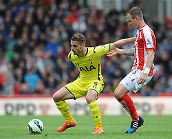 Tottenham Hotspur's Roberto Soldado controls the ball under pressure from Stoke City's Glenn Whelan - Photo mandatory by-line: Dougie Allward/JMP - Mobile: 07966 386802 - 09/05/2015 - SPORT - Football - Stoke - Britannia Stadium<br />  - Stoke v Tottenham Hotspur - Barclays Premier League
