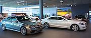 Mercedes-AMG E63 AMG Saloon V8 biturbo (left) and Mercedes C350 AMG Sport (right) in Mercedes-AMG showroom in Stuttgart, Germany