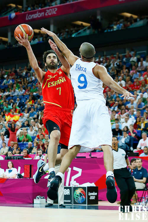 08 August 2012: Spain Juan-Carlos Navarro goes for the layup against Tony Parker during 66-59 Team Spain victory over Team France, during the men's basketball quarter-finals, at the 02 Arena, in London, Great Britain.