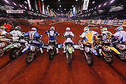Endurocross racers launch from the starting gate at the 2007 Maxxis AMA Endurocross at the Lazy E Arena in Guthrie, Oklahoma.  Event was won by David Knight #101 on KTM