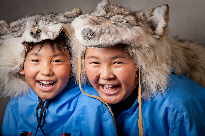 Iñupiat brothers in wolf hats prepare for a dance presentation at the World Eskimo and Indian Olympics - WEIO - in Fairbanks, Alaska.