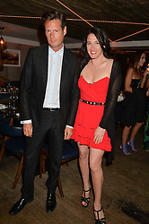 PERCY PARKER and AMY MOLYNEAUX at the launch of Geisha at Ramusake hosted by Piers Adam and Marc Burton at Ramusake, 92B Old Brompton Road, London on 11th June 2015.
