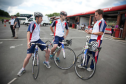 © Licensed to London News Pictures. 19/06/12. Brands Hatch, Kent. L to R Tom Stanton National GB coach, Chris Furber Lead GB Coach and Gareth Shepherd Programme Manager discussing tactics at Brands Hatch, Kent. Up to 150 international athletes come to train at the race circuit at Brands Hatch in Kent for the Paralympic Road Cycling competition taking place on 5-8 September 2012. Picture credit should read Manu Palomeque/LNP