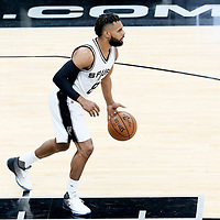 01 May 2017: San Antonio Spurs guard Patty Mills (8) brings the ball up court during the Houston Rockets 126-99 victory over the San Antonio Spurs, in game 1 of the Western Conference Semi Finals, at the AT&T Center, San Antonio, Texas, USA.