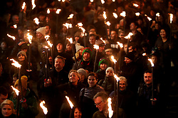 Members of of the public take part in a torchlight procession along the Royal Mile during Edinburgh Hogmanay celebrations.