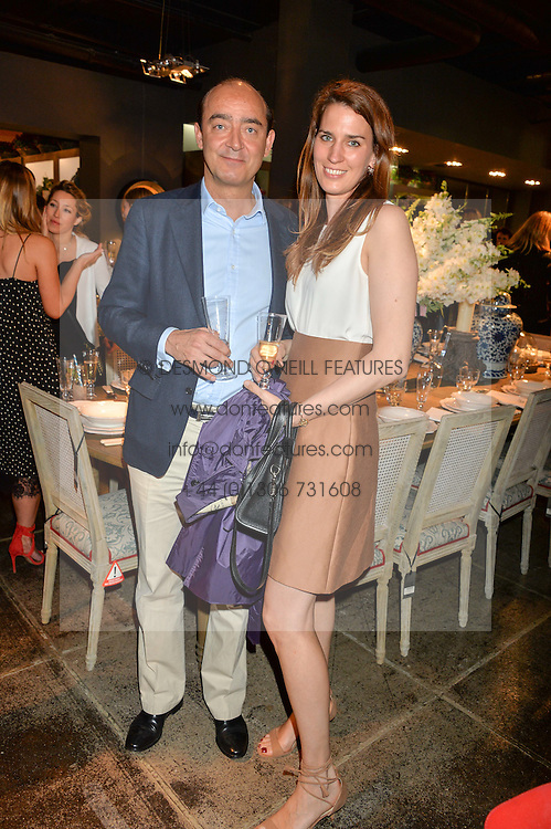 BARON FREDERICK HOPKINS and his wife KATRINA at a party to celebrate the publication of 'Feeding The Future' by Lohralee Astor and Tali Shine held at OKA, 155-167 Fulham Road, London on 8th June 2016.