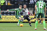 Jake Reeves of AFC Wimbledon and Curtis Thompson of Notts County tussle during the Sky Bet League 2 match between Notts County and AFC Wimbledon at Meadow Lane, Nottingham, England on 23 January 2016. Photo by Stuart Butcher.
