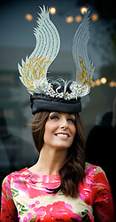 LIVERPOOL, ENGLAND, Thursday, April 7, 2011: Model Rossana Stocchino shows off the official Liverpool Day Hat, created by local designer Hayley Marsden, during Liverpool Day on Day One of the Aintree Grand National Festival at Aintree Racecourse. (Photo by David Rawcliffe/Propaganda)