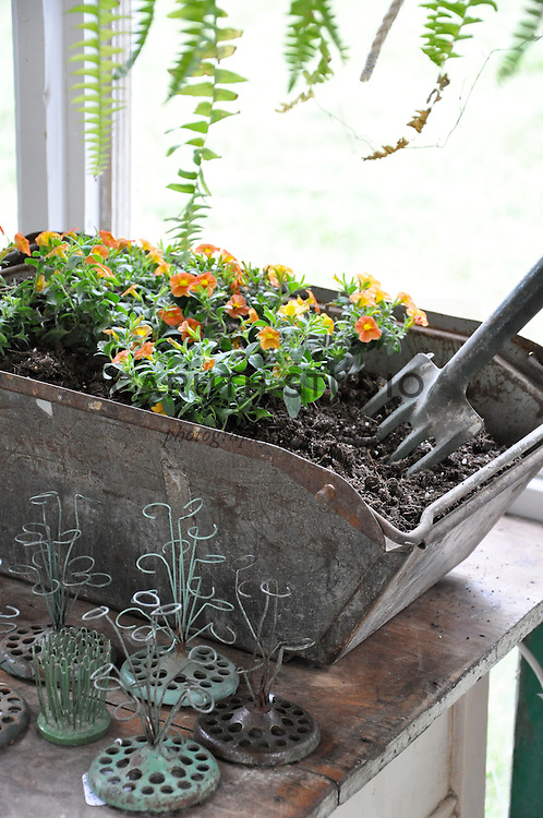 Architectural Salvage Shed: Detail of vintage metal bin and flower frogs