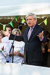 Westminster, London, June 6th 2016.Speaker of the House of Commons John Bercow addresses the crowd as teams from uk industry as well as the House of Commons and the House of Lords compete in the annual McMillan Cancer Charity tug o' war.