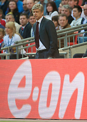 LONDON, ENGLAND - Saturday, April 18, 2009: Arsenal's manager Arsene Wenger during the FA Cup Semi-Final match against Chelsea at Wembley. (Photo by: David Rawcliffe/Propaganda)