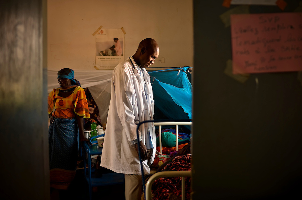 Dr. Mahamad Abaysho checks on a patient recovering from a miscarriage at a free maternity clinic in Goz Beida, Chad.