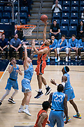 Cal State Fullerton Titans forward Vincent Lee (13) scores against San Diego Toreros forward Alex Floresca (15) during an NCAA basketball game, Wednesday, Dec. 11, 2019, in Fullerton, Calif. San Diego defeated CSUF 66-54. (Jon Endow/Image of Sport)