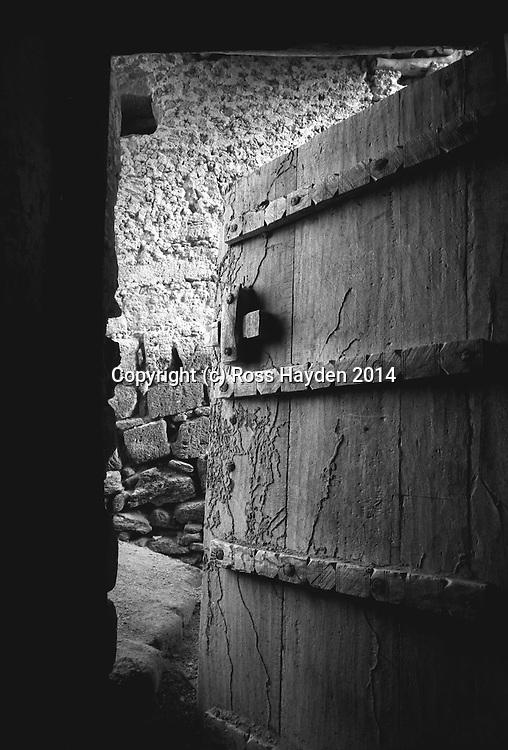 Door Ajar - old wooden door of abandoned house in Salalah, Dhofar, Oman