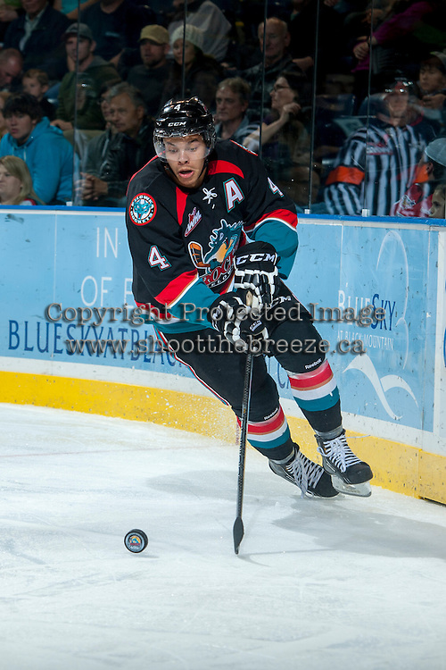KELOWNA, CANADA - OCTOBER 19: Madison Bowey #4 of the Kelowna Rockets skates with the puck against the Prince George Cougars on October 19, 2013 at Prospera Place in Kelowna, British Columbia, Canada.   (Photo by Marissa Baecker/Shoot the Breeze)  ***  Local Caption  ***