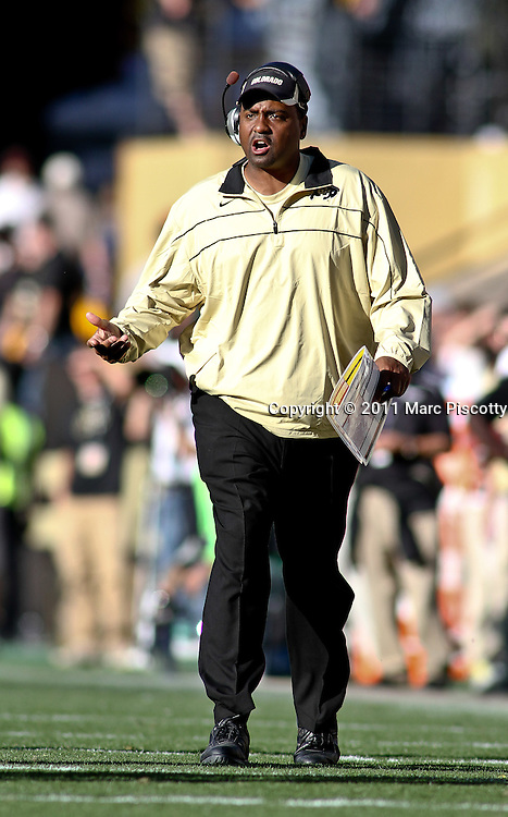 SHOT 10/22/11 4:07:06 PM - Colorado first year head football coach Jon Embree questions a call against Oregon during their regular season PAC-12 game at Folsom Field in Boulder, Co. Oregon won the game 45-2. (Photo by Marc Piscotty /  © 2011)
