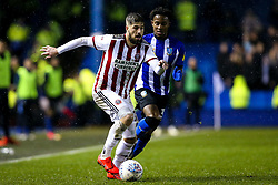Kieron Freeman of Sheffield United goes past Rolando Aarons of Sheffield Wednesday - Mandatory by-line: Robbie Stephenson/JMP - 04/03/2019 - FOOTBALL - Hillsborough - Sheffield, England - Sheffield Wednesday v Sheffield United - Sky Bet Championship