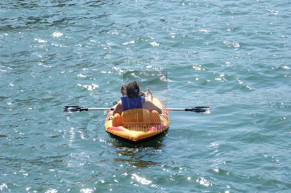Man relaxing in an inflatable kayak