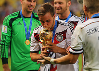 Scorer of the winning goal Mario Gotze of Germany kisses the World Cup Trophy