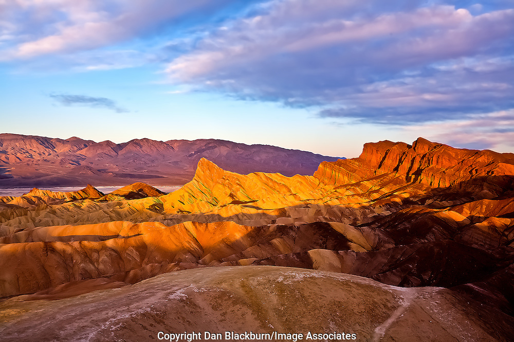 Sunrise at Zabriskie Point and on Manly Beacon in Death Valley, California.