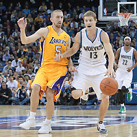 04 October 2010: Minnesota Timberwolves guard Luke Ridnour brings the ball upcourt against Los Angeles Lakers guard Steve Blake during the Minnesota Timberwolves 111-92 victory over the Los Angeles Lakers, during 2010 NBA Europe Live, at the O2 Arena in London, England.
