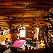 Num-Ti-Jah Lodge is nestled next to  Bow Lake in Alberta. Lodge guests enjoy the communal sitting area.
