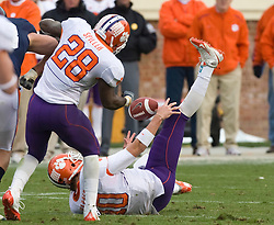 Clemson quarterback Cullen Harper (10) tries to recover a bad snap against UVA.  Virginia ended up with possession.  The Clemson Tigers defeated the Virginia Cavaliers 13-3 in NCAA Division 1 football at Scott Stadium on the Grounds of the University of Virginia in Charlottesville, VA on November 22, 2008.