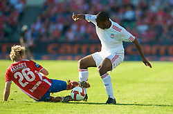 OSLO, NORWAY - Wednesday, August 5, 2009: Liverpool's Ryan Babel in action against FC Lyn Oslo's Endre Fotland Kundsen during a preseason match at the Bislett Stadion. (Pic by David Rawcliffe/Propaganda)