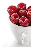 Raspberries in white cup - close-up