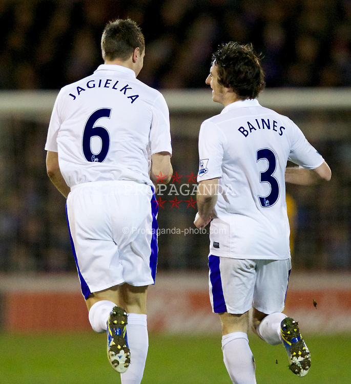 OLDHAM, ENGLAND - Saturday, February 16, 2013: Everton's Phil Jagielka celebrates scoring the second goal against Oldham Athletic with team-mate Leighton Baines during the FA Cup 5th Round match at Boundary Park. (Pic by Vegard Grott/Propaganda)