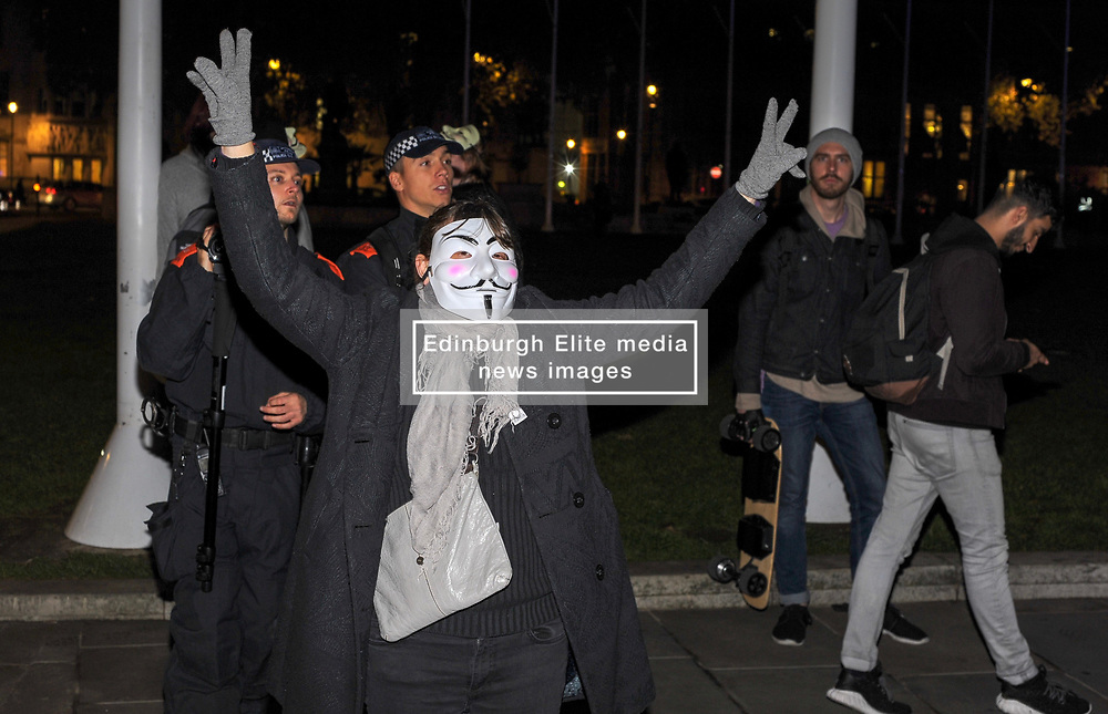 A protester poses for photos on Parliament Square during the annual 'Million Mask March' demonstration took place around around Westminster. London, 05 November 2018.
