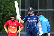 Scotland captain Kyle Coetzer celebrates his 50 in front of a frustrated Sikander Raza during the One Day International match between Scotland and Zimbabwe at Grange Cricket Club, Edinburgh, Scotland on 17 June 2017. Photo by Kevin Murray.