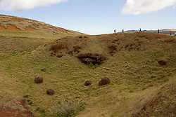 Chile, Easter Island: Puna Pau, the quarry for red stone topknots that were put on the statues or moai.  Most Moai were believed to have these multi-ton hats..Photo #: ch305-33165.Photo copyright Lee Foster www.fostertravel.com lee@fostertravel.com 510-549-2202