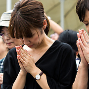 NAGASAKI, JAPAN - AUGUST 9 : Visitors pray for the atomic bomb victims in front of the Nagasaki Peace Park in Nagasaki, southern Japan on Wednesday, August 9, 2017. Japan marked the 72nd anniversary of the atomic bombing on Nagasaki. (Photo: Richard Atrero de Guzman/AFLO)