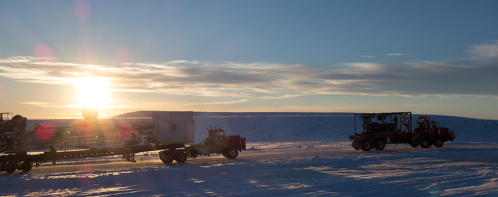 A Cruz Construction equipment haul rig components up an ice road to a Linc Energy ice pad in Umiat, Alaska, during the 2013-2014 winter season. Cruz Construction provided rig support for Linc Energy's drilling program in Umiat.