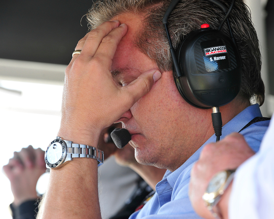 Chip Ganassi team members react to a crash in turn one that left Sage Karam and Justin Wilson injured on August 23rd, 2015, at Pocono Raceway in Long Pond. (Chris Post | lehighvalleylive.com)