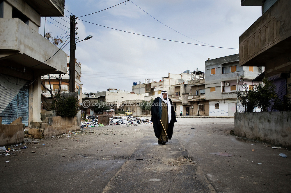 SYRIA, HOMS, Baba Amro: A Syrian man walks in Baba Amro, southern neighborhood of Homs, as Al Assad Army is bombing, on February 07, 2012.  ALESSIO ROMENZI