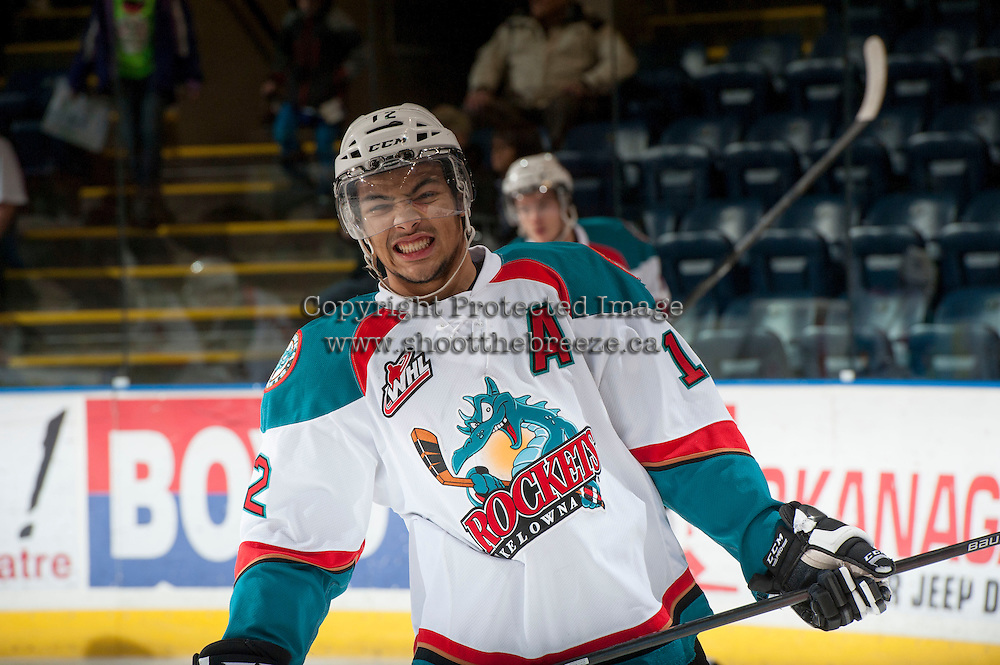 KELOWNA, CANADA - DECEMBER 27: Tyrell Goulbourne #12 of the Kelowna Rockets hams it up on the ice during warm up against the Kamloops Blazers on December 27, 2013 at Prospera Place in Kelowna, British Columbia, Canada.   (Photo by Marissa Baecker/Shoot the Breeze)  ***  Local Caption  ***