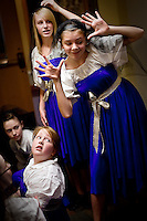 "JEROME A. POLLOS/Press..Rachael Hogan, 13, right, and Alli Ballard, 16, practice their dance routine as Shelby Hankins, 11, looks back to watch Wednesday before a play at the Ray and Joan Kroc Community Center. Children participated in the Christian Youth Theater ""Play in a Day"" event where they audition, gather props and costumes, put together a set, rehearse and perform an entire play in one day."