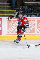 KELOWNA, CANADA - DECEMBER 8:  Cody Fowlie #18 of the Kelowna Rockets reaches for the puck against the Prince George Cougars at the Kelowna Rockets on December 8, 2012 at Prospera Place in Kelowna, British Columbia, Canada (Photo by Marissa Baecker/Shoot the Breeze) *** Local Caption ***