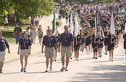 16597Freshman Convocation March from Convo to College Green: Pres. McDavis greeting walking w/students
