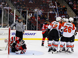 Oct 24, 2008; Newark, NJ, USA; Philadelphia Flyers right wing Mike Knuble (22) and the Flyers celebrate after scoring on New Jersey Devils goalie Martin Brodeur (30) during the first period at the Prudential Center.