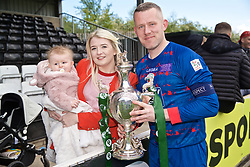 RHOSYMEDRE, WALES - Sunday, May 5, 2019: The New Saints captain goalkeeper Paul Harrison celebrates with the trophy and his wife and 8-month-old daughter Eva after the FAW JD Welsh Cup Final between Connah's Quay Nomads and The New Saints at The Rock. The New Saints won 3-0. (Pic by David Rawcliffe/Propaganda)