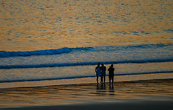 © Licensed to London News Pictures. 13/09/2020. Swansea, UK. Youngsters pose for a selfie with the sea in the background on a beautiful evening in south Wales. The UK enjoyed a fine weekend of warm and sunny weather. Photo credit: Robert Melen/LNP