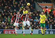 Norwich City's Christoph Zimmermann and Sheffield United's Leon Clarke during the EFL Sky Bet Championship match between Norwich City and Sheffield Utd at Carrow Road, Norwich, England on 20 January 2018. Photo by John Marsh.