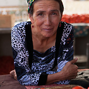 A tomato seller in a Dashoguz market, Turkmenistan