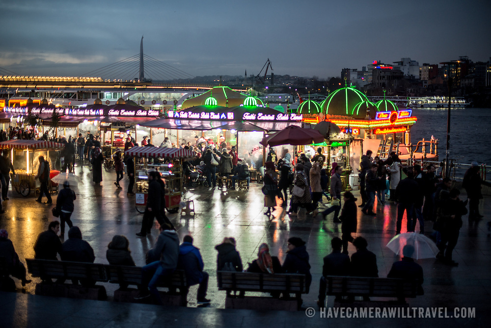 The busy waterfront district of Eminonu in Istanbul, at the foot of the Galata Bridge.