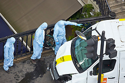 **PREVIOUSLY UNSEEN PICTURES** <br /> &copy; Licensed to London News Pictures. 04/06/2017. LONDON, UK.  Forensic officers remove the white van used by Khuram Butt, Rachid Redouane and Youssef Zaghba to murder at least eight people on London Bridge and in nearby Borough Market the day after the attack unfolded. Photo credit: Cliff Hide/LNP