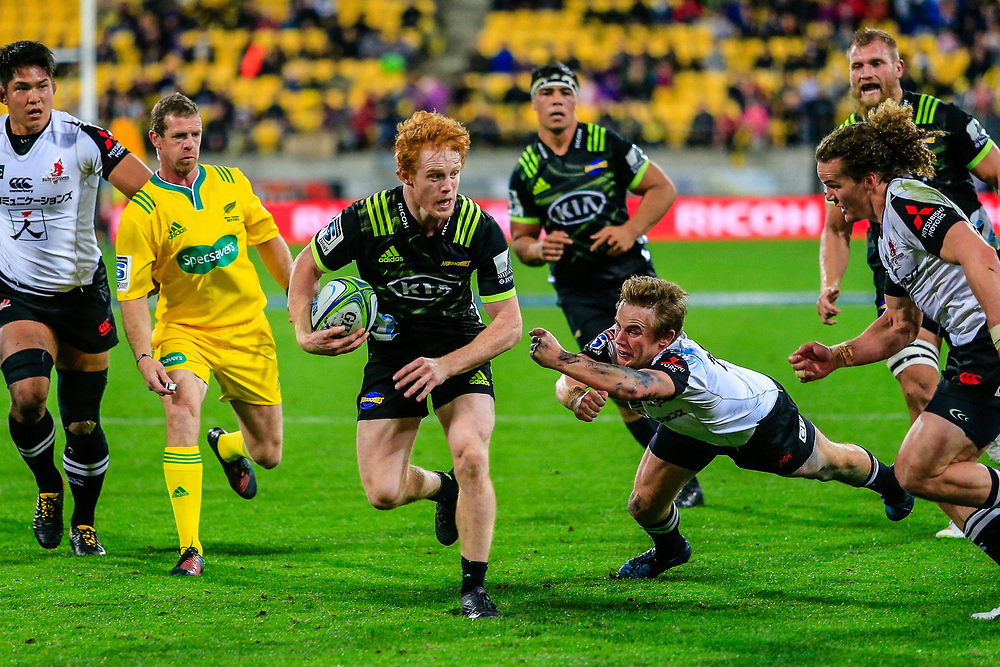 Finlay Christie running during the Super Rugby union game between Hurricanes and Sunwolves, played at Westpac Stadium, Wellington, New Zealand on 27 April 2018.   Hurricanes won 43-15.